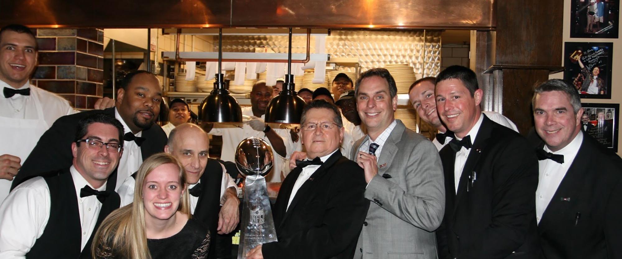 St. Elmo Steak House management infront of restaurant